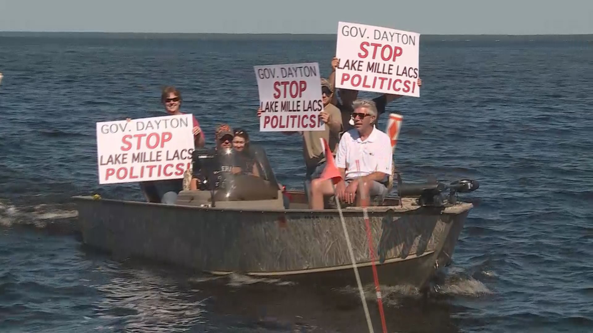 Protesters greet dayton when he fishes on for Mille lacs lake fishing